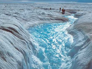 Meltwater flowing off an ice sheet in Greenland
